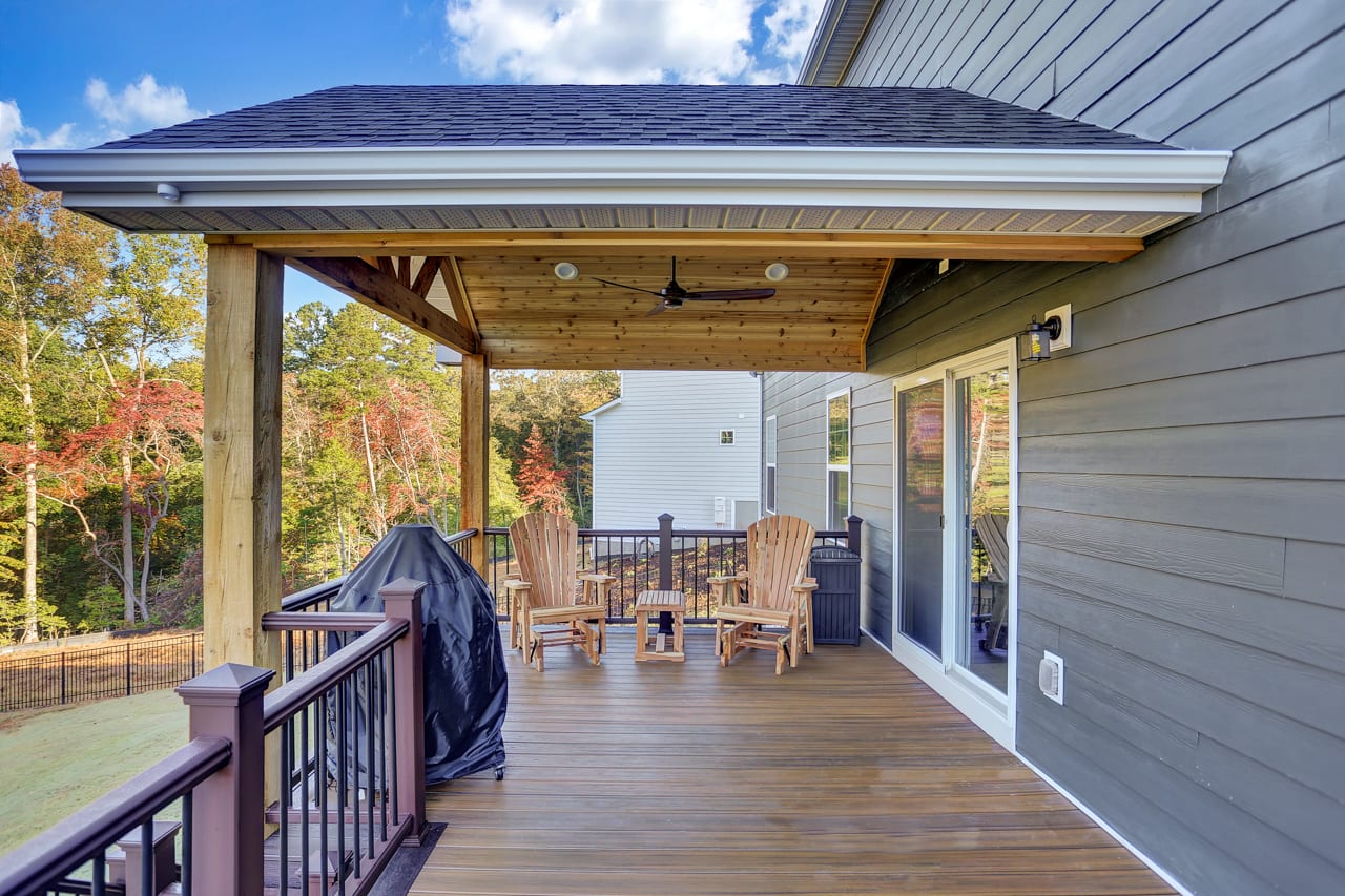 a deck with a covered porch area