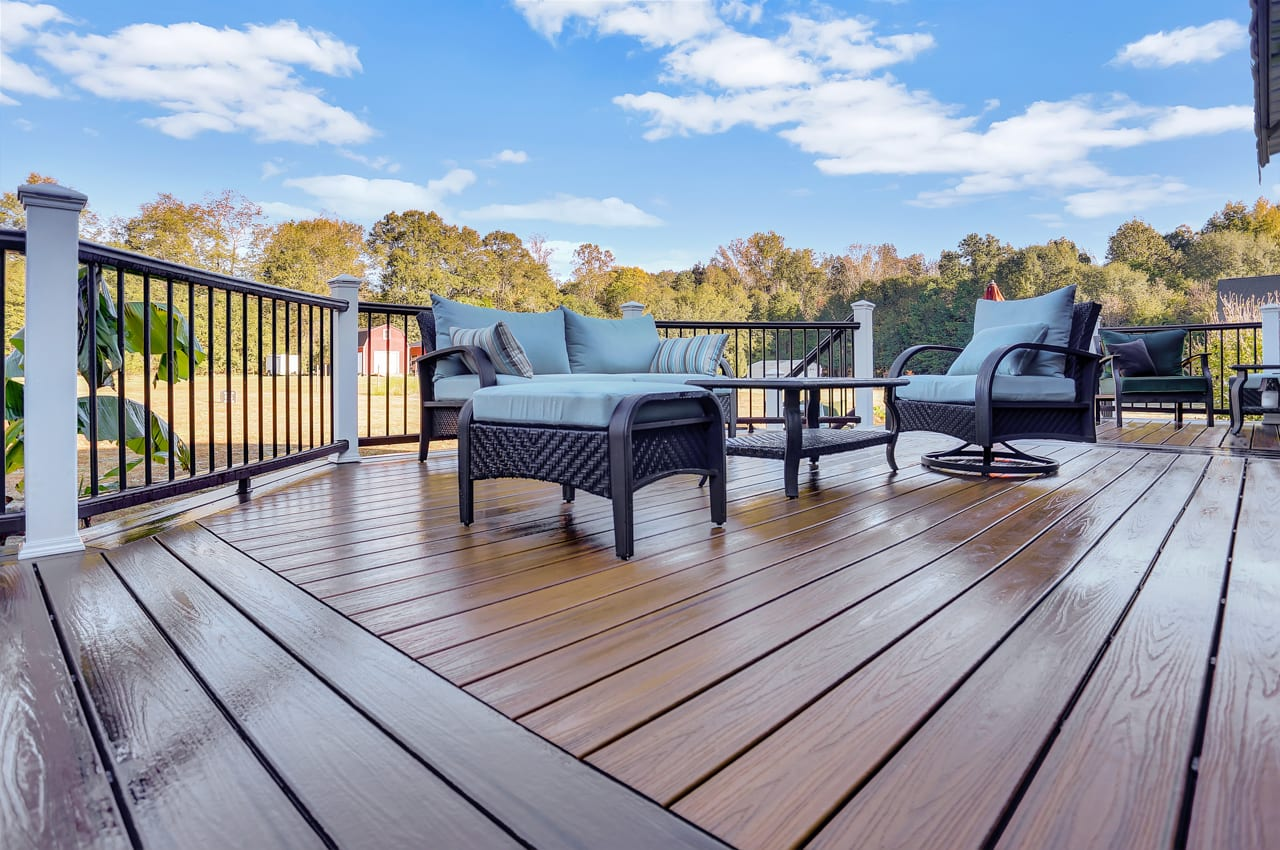 outdoor furniture is sitting on a deck