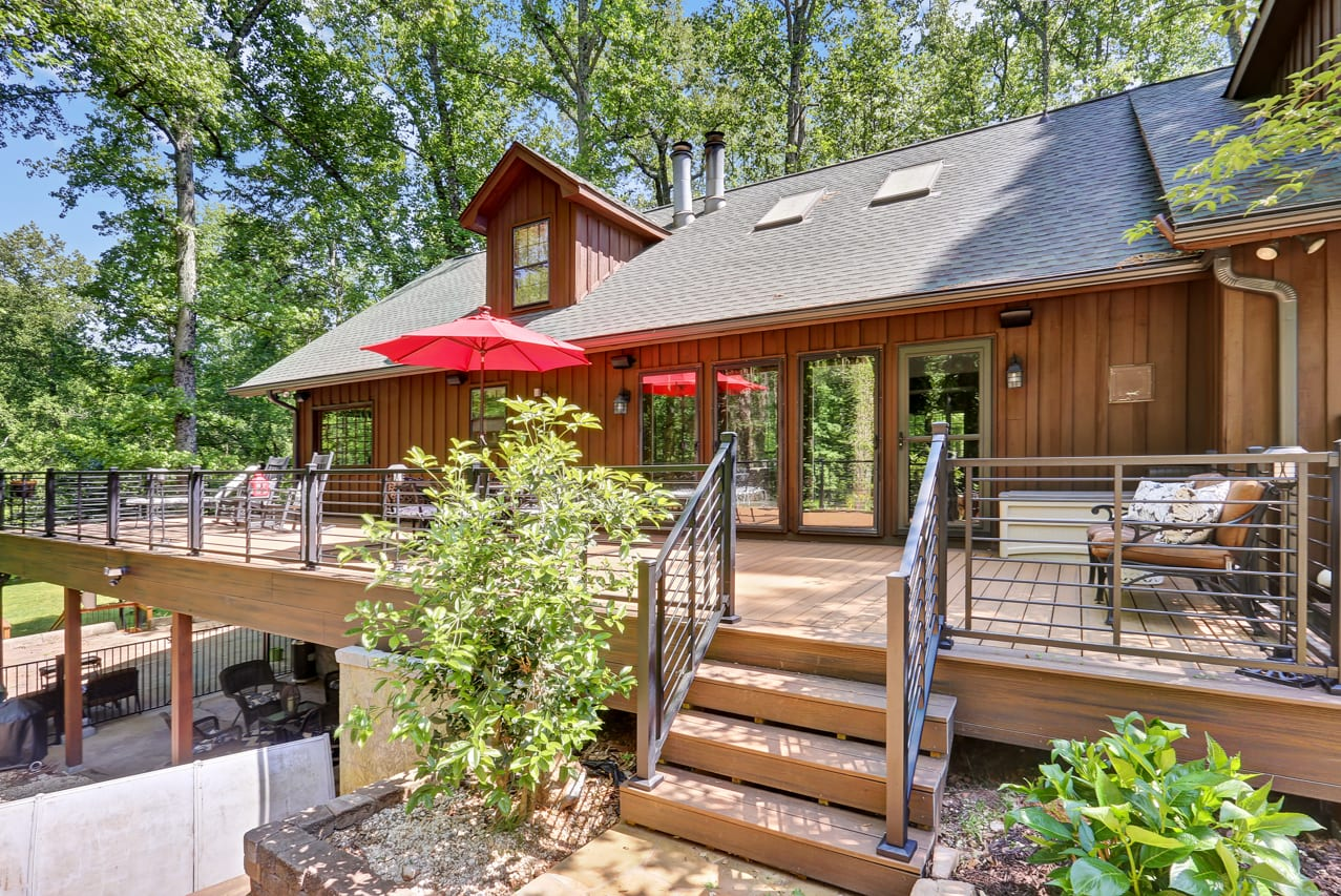 a rustic-style deck attached to a house
